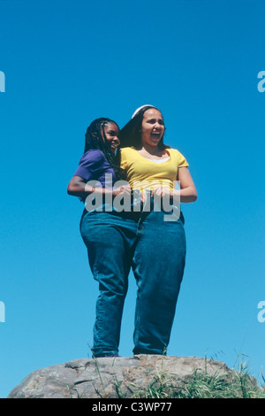 2 African American teenage girls wearing oversize pants - Stock Image