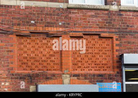 Exterior of former St Thomas School, Bentinck Street Farnworth with building sponsorship memorial bricks built into - Stock Image