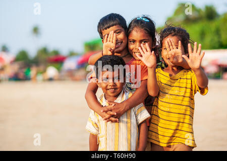 GOA, INDIA - NOVEMBER 08, 2011: Unidentified indian children playing at the beach in Goa in India - Stock Image