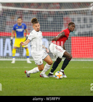 Optus Stadium, Burswood, Perth, W Australia. 17th July 2019. Manchester United versus Leeds United; pre-season tour; Kalvin Phillips of Leeds United chases the loose ball ahead of Paul Pogba of Manchester United Credit: Action Plus Sports Images/Alamy Live News - Stock Image