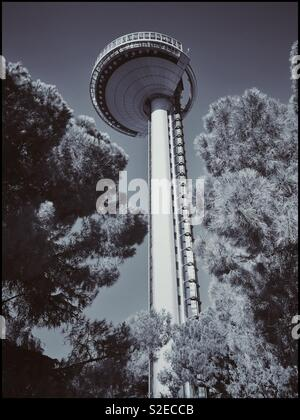 A monochrome image of the Faro De Moncloa - a 92 metre high observation tower in Madrid, Spain. Panoramic views are possible by elevator access. Photo © COLIN HOSKINS. - Stock Image