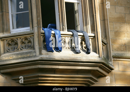 Two Pairs of Jeans Drying on the Sill of an Oxford Window, Oxford, Oxfordshire, UK - Stock Image