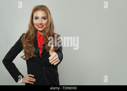 Happy woman in suit with thumb up on white banner background - Stock Image