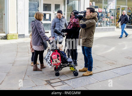 Swindon, Wiltshire, UK. 19th February, 2019. A TV news team are pictured in the centre of Swindon talking to shoppers as local people react to the news today that Honda has confirmed that they will be closing their car factory in the town.   Credit: Lynchpics/Alamy Live News - Stock Image