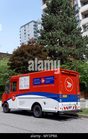 Canada Post mail delivery truck parked on a residential street in Vancouver, BC, Canada - Stock Image
