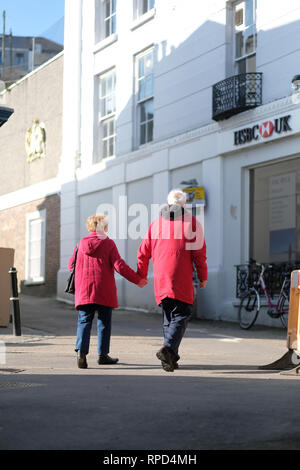 A retired couple holding hands in Falmouth, Cornwall - Stock Image