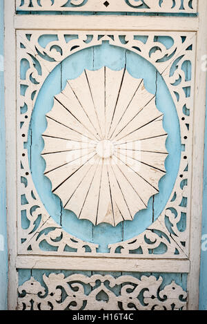 Hand carved wood detail with ornate details painted in white and blue paint - Stock Image