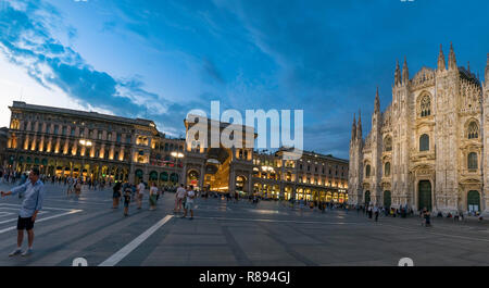 Horizontal streetview of the Milan Cathedral and Galleria Vittorio Emanuele II shopping centre at sunset in Milan, Italy. - Stock Image