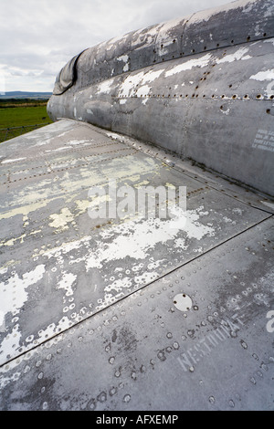 Retired parked airplane, mid section of wing and fuselage, ex Warsaw pact aircraft - Stock Image