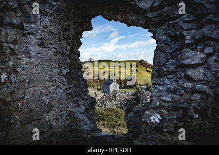A Small Church Seen Through The Hole in the Wall at The Rock Of Dunamase, County Laois in Ireland - Stock Image