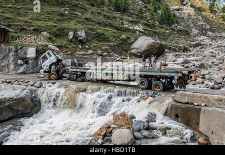 Broken down truck in a ford on Lowari Pass in northern Pakistan - Stock Image