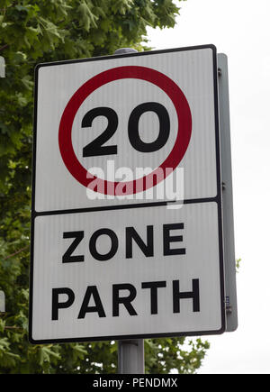 Bilingual street sign in English and Welsh stating a speed limit or parth of 20 miles per hour Wrexham Wales June 2018 - Stock Image