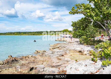 Tourists enjoy the calm clear waters of the Bay of Pigs Cuba. - Stock Image