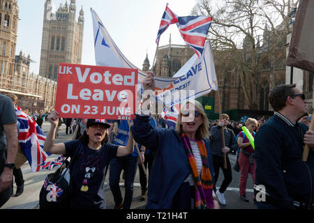 Protestors marching  outside Parliament to demonstrate against the delay to Brexit  on the day the UK should have left  the EU - Stock Image