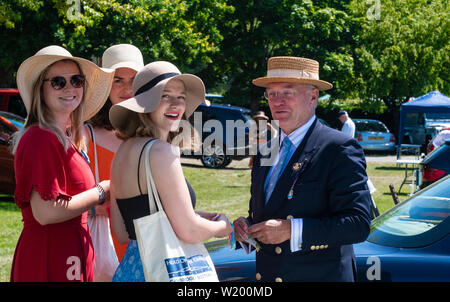 Henley on Thames, Berkshire, UK. 4th July, 2019. Henley Royal Regatta visitors talking with the coordinator of the Dutch Rowing Teams   in Lion Meadow car park . Credit Gary Blake/Alamy Live - Stock Image