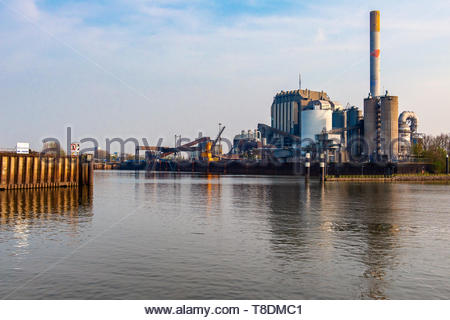 Nijmegen, Netherlands. Still in use Grane Silo's and local Poweer Plant at the docks of inlage barge harbour Port of Nijmegen, seen from the River Waa - Stock Image