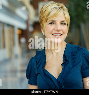 Portrait of smiling middle-aged woman - Stock Image