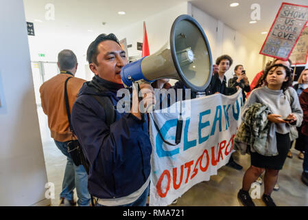 London, UK. 14th February 2019. IWGB President Henry Chango Lopez speaks in the foyer of the Ben Pimlott buidling at the launch their campaign for Goldmsiths, University of London, to directly employ its security officers. Currently they are employed by CIS Security Ltd on low pay and minimal conditions of service, and CIS routinely flouts its legal responsibilities on statutory sick pay and holidays. Credit: Peter Marshall/Alamy Live News - Stock Image