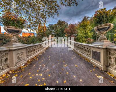 Bow Bridge in New York City, Central Park Manhattan in late autmn - Stock Image