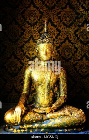 Ancient Golden Buddha Image in Main Hall. - Stock Image