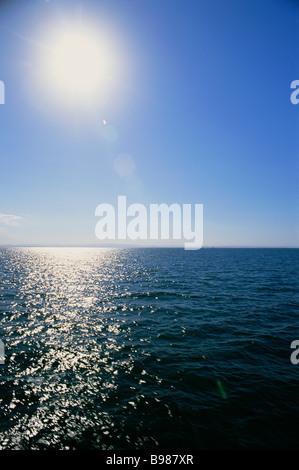 Sun over ocean - Stock Image