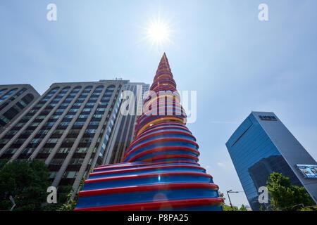 Low angle shot of artistic sculpture by Claes Oldenburg & Coosje van Bruggen entitled Spring. Seoul, South Korea. - Stock Image