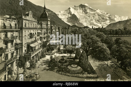 Interlaken and the Jungfrau, Bern, Switzerland, with the Hotel Viktoria and Hotel Jungfrau. - Stock Image