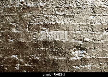Brick wall with gold  paint as a background for an advert in Shoreditch East London UK . KATHY DEWITT - Stock Image