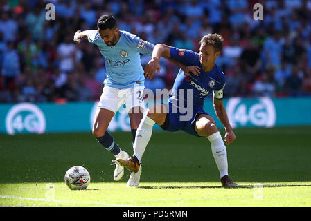 Cesar Azpilicueta of Chelsea challenges Riyad Mahrez of Manchester City during the FA Community Shield match between Chelsea and Manchester City at Wembley Stadium in London. 05 Aug 2018 - Stock Image