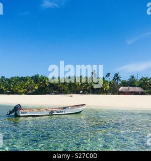 A boat anchored at Tavarua island. Tavarua island resort, Fiji. - Stock Image