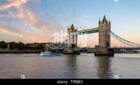 London, England, UK - September 27, 2018: Clouds light up over London's iconic Tower Bridge at sunset. - Stock Image