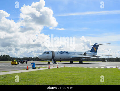 Alliance Airlines VH-NKU Fokker 70 Aircraft on the apron at Brisbane Airport, domestic terminal, Queensland, QLD, Australia - Stock Image