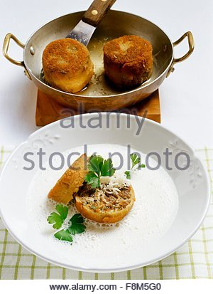 Horseraddish foam with baked oxtails - Stock Image