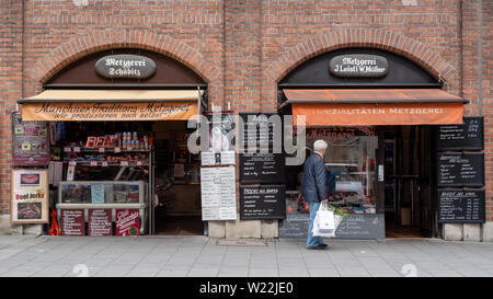 Munich, Bavaria, Germany - May 29, 2019. Facade of a store selling preserved meats at the Victuals Market - Stock Image