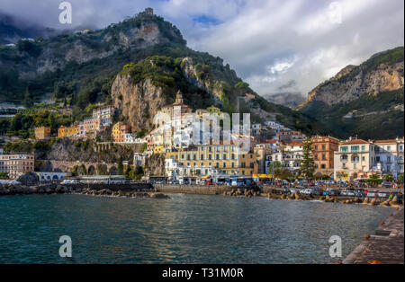 Amalfi cost in Italy. I am absolutely sure Amalfi is the most beautiful town by Naples cost. I  was there in October 2018. Yeo, colourful houses lande - Stock Image