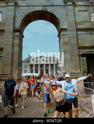 Glasgow, Scotland, UK. 12th July, 2019. Clyde street saw throngs of youngsters on the road to TRNSMT festival at Glasgow Green at the Arch entrance to the park. Credit: gerard ferry/Alamy Live News - Stock Image