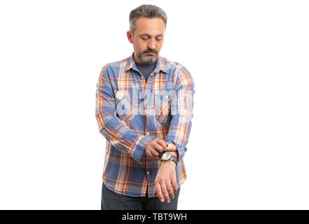 Man rolling up sleeves of orange and blue plaid shirt as getting ready concept isolated on white background - Stock Image