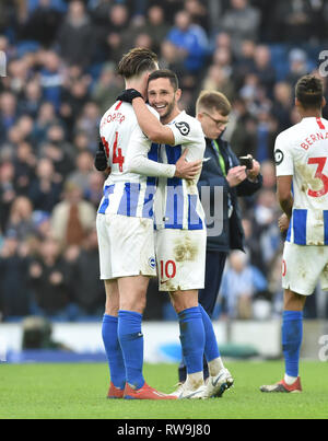 Florin Andone of Brighton (right) celebrates their win with Anthony Knockaert in the Premier League match between Brighton & Hove Albion and Huddersfield Town at the American Express Community Stadium . 02 March 2019 - Stock Image