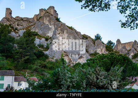 View on medieval houses and castle ruines in Provence in sunny day, South of France, vacation and tourist destination - Stock Image