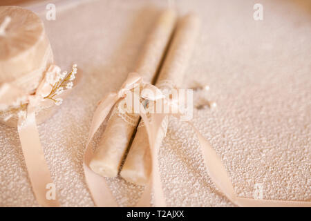 Candles tied by ribbon during wedding - Stock Image