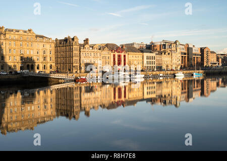 Newcastle upon Tyne quayside buildings reflected in the river Tyne, North East England, UK - Stock Image