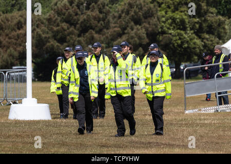 A group of cadets walking together in high visibility jackets - Stock Image