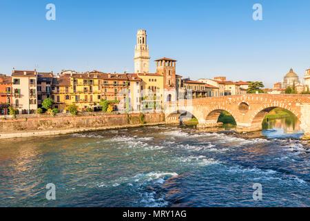 Ponte Pietra (Stone Bridge) and Verona old town at sunrise. Verona, Veneto, Italy - Stock Image