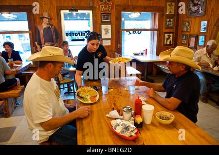 John Wayne poster in a Spanish restaurant Hill country, Bandera Texas, USA - Stock Image