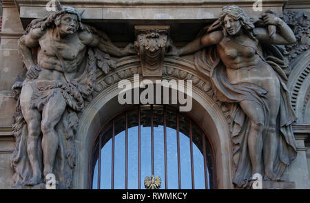 Atlas and Caryatid at the entrance to the National Bank of Poland in Gdansk - Stock Image