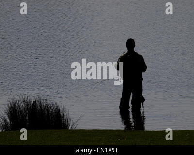 Silhouette of a fisherman, UK - Stock Image