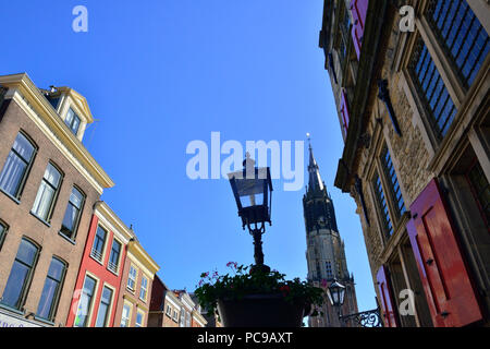 The centre of Delft, Holland, Netherlands showing traditional buildings together with New Church or Nieuwe Kerk - Stock Image