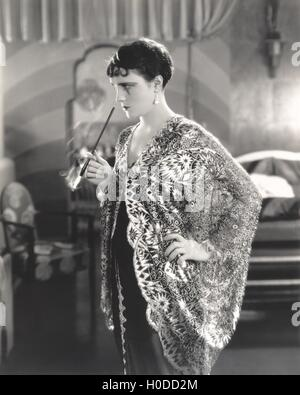Woman with cigarette holder - Stock Image