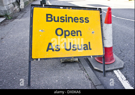Road sign stating business open as usual during period of road works - Stock Image