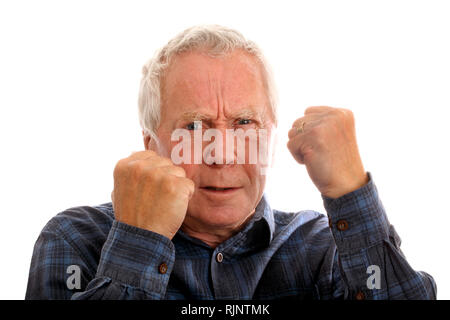 Angry or threatening man approximately 65 years old - Stock Image